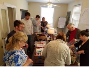Turpin Cares volunteers gather to assemble winter care packages